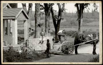 A horse and wagon loaded with Roy Toy building sets leaves the original toy factory, bound for the Machias train station. (image courtesy of Roy Toy)