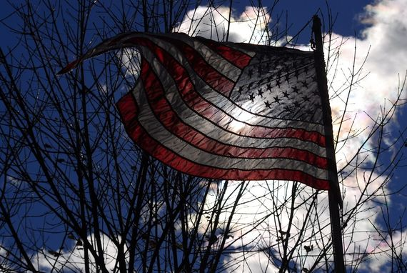 american flag backlit by the sun