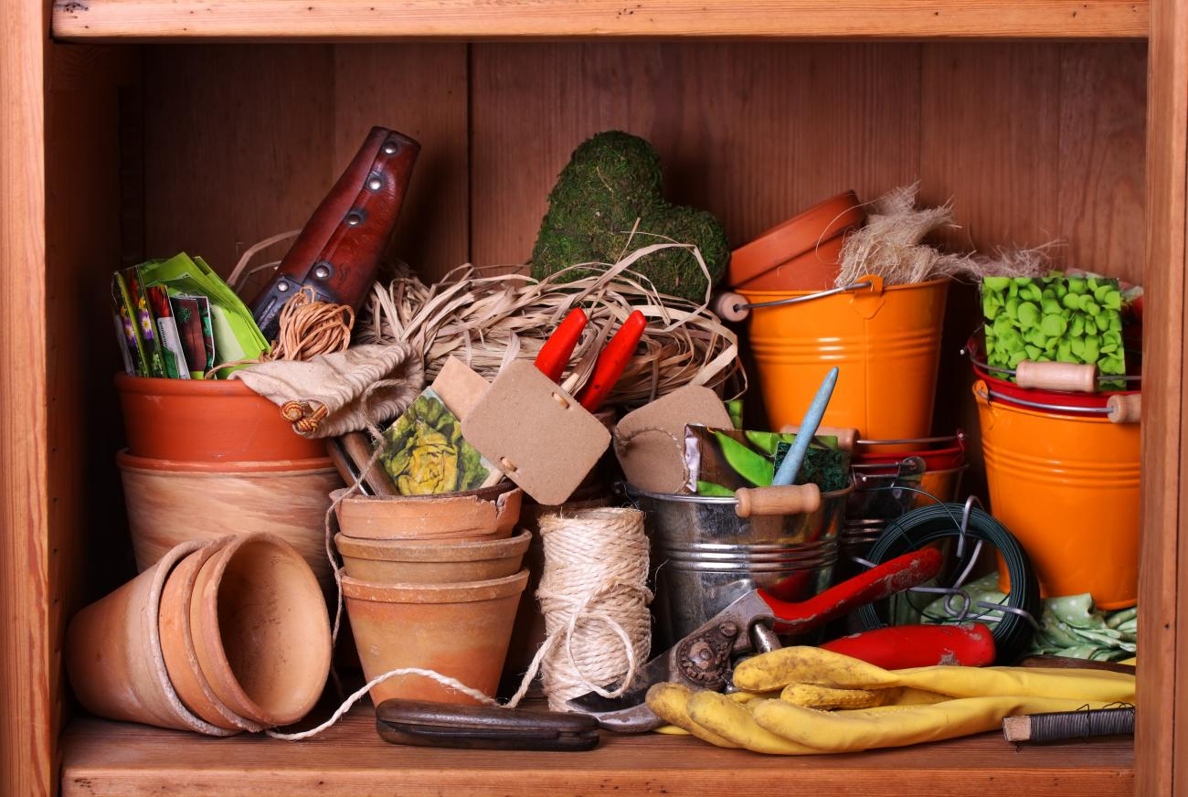 Potting shed with different gardening tools, pots, seeds, and more