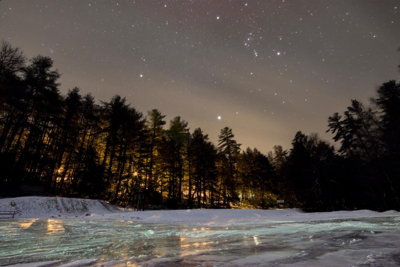 Orion and Sirius reflect off a frozen lake