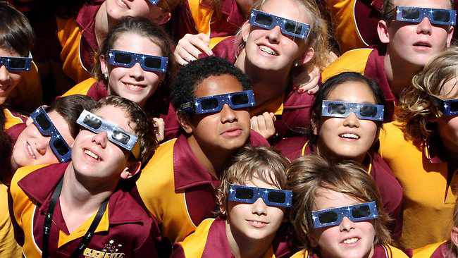 Kids watching solar eclipse