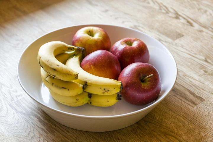 Apples and bananas. Photo by Martin Carlsson/ShutterStock.
