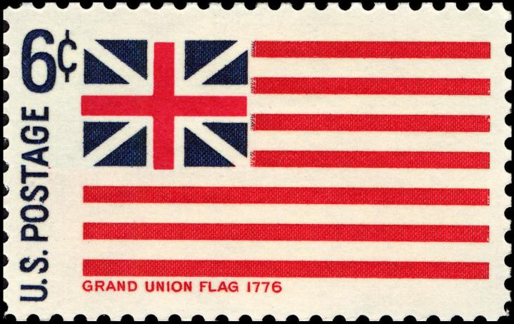The Grand Union Flag, the original flag of the United States, represented here on a 1968 postal stamp.