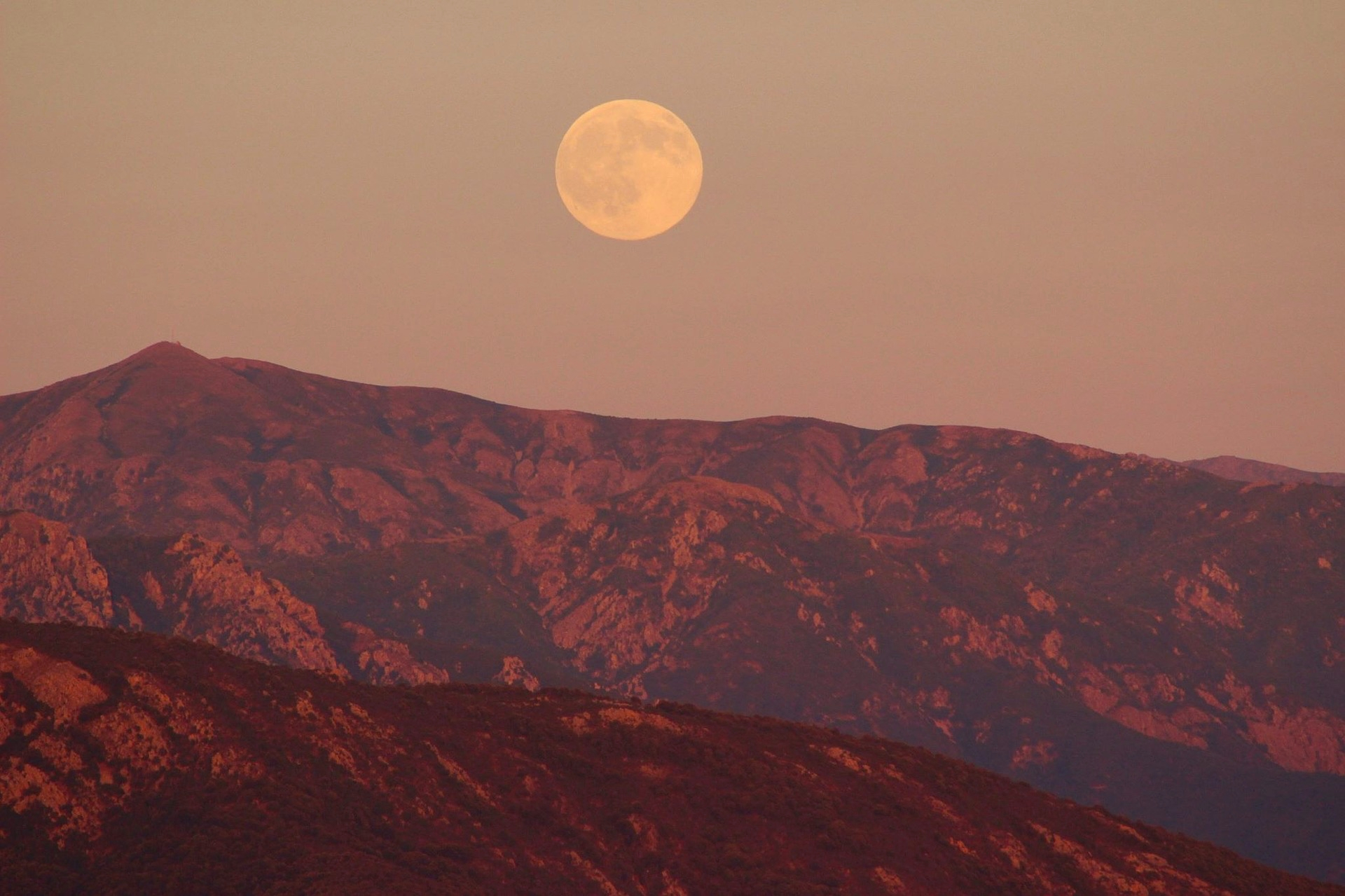 Full Pink Moon over mountains