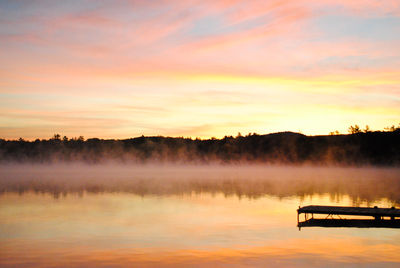 Sunrise on lake with fog